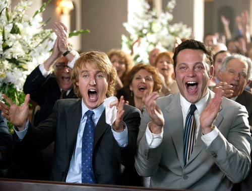 men clapping at a wedding